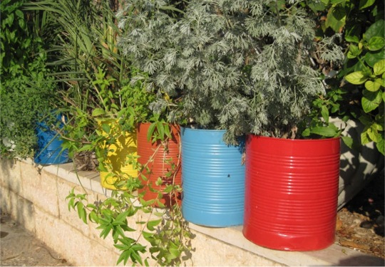 Herb Pots made from recycled tins and painted in bright colours