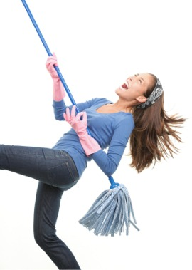 A woman getting organised in the home and dancing with her mop