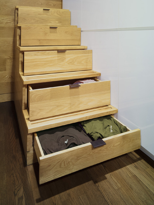 Storage drawers in stairs leading up to loft bed