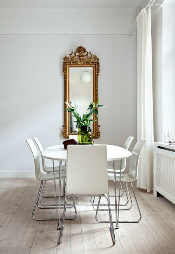 Dining table with ornate mirror