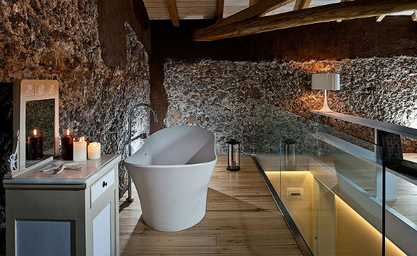 freestanding bath and stone walls