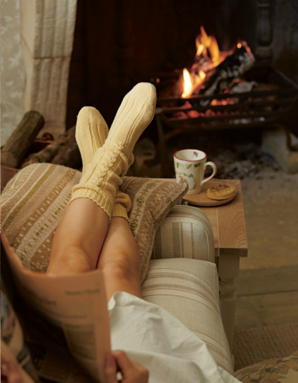hygge beside a fireplace