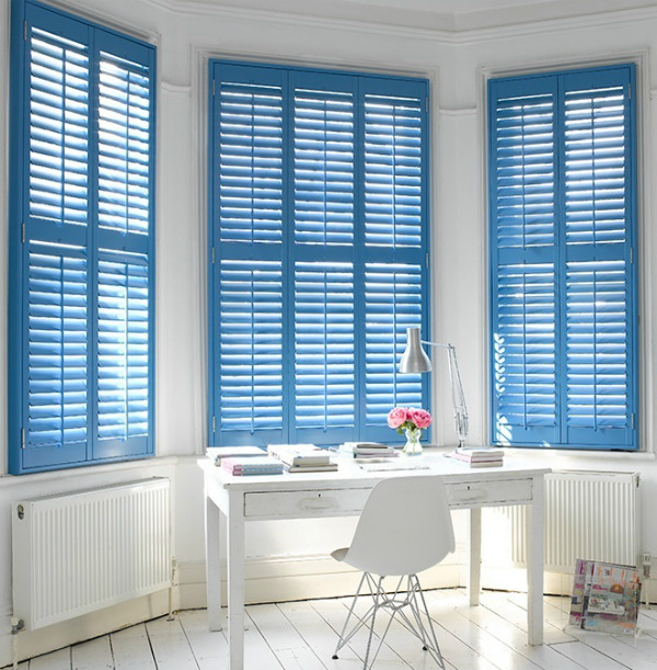 Blue plantation blinds in a home office