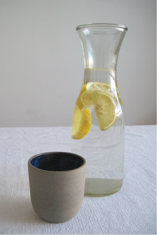 Rustic ceramic cup and carafe of lemon water from Mocha UK
