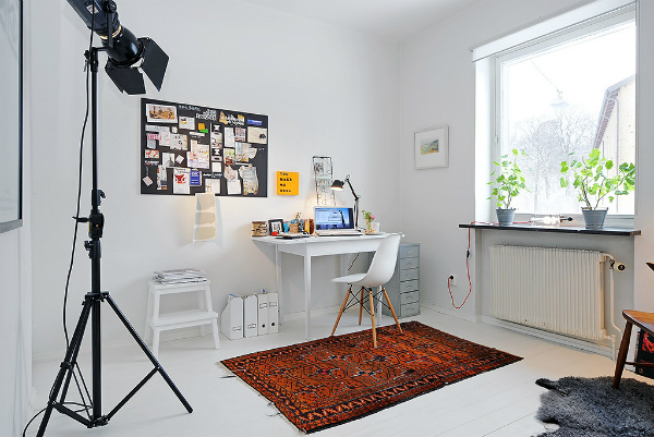 Home office with photographer's tripod floor lamp