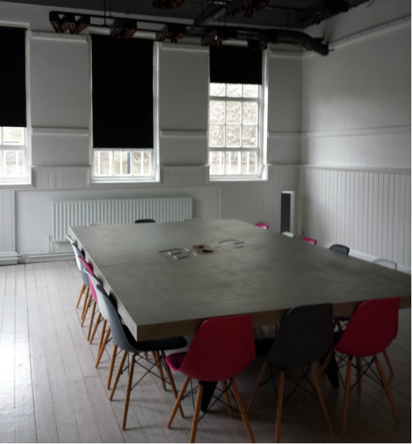 Meeting room in former Dublin school with Eames chairs