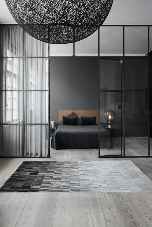 Minimalist bedroom interior with black wall