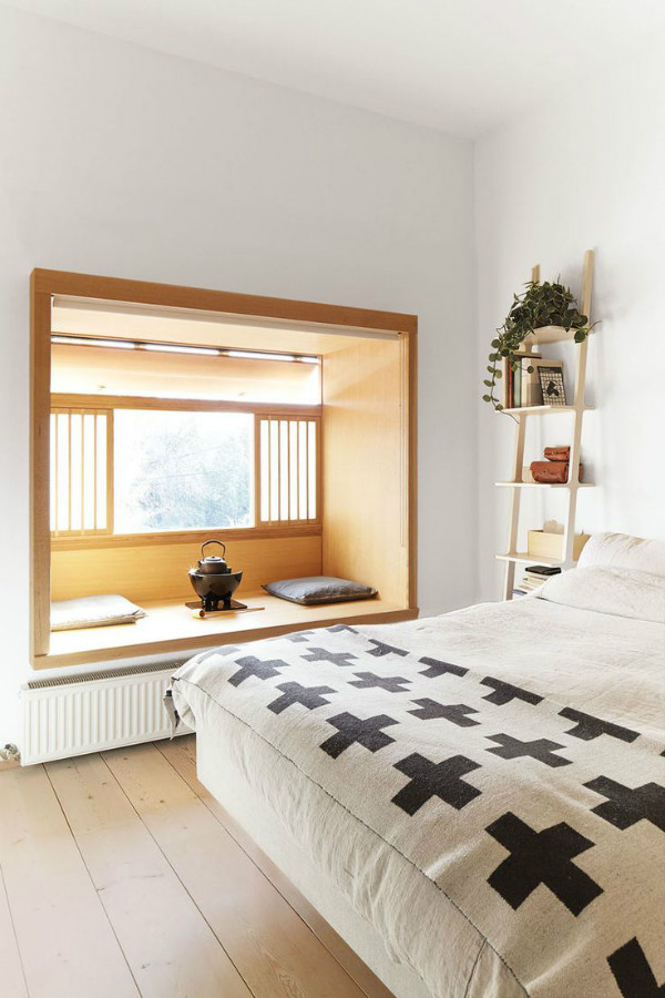Bedroom inspired by nature with wooden window seat ledge