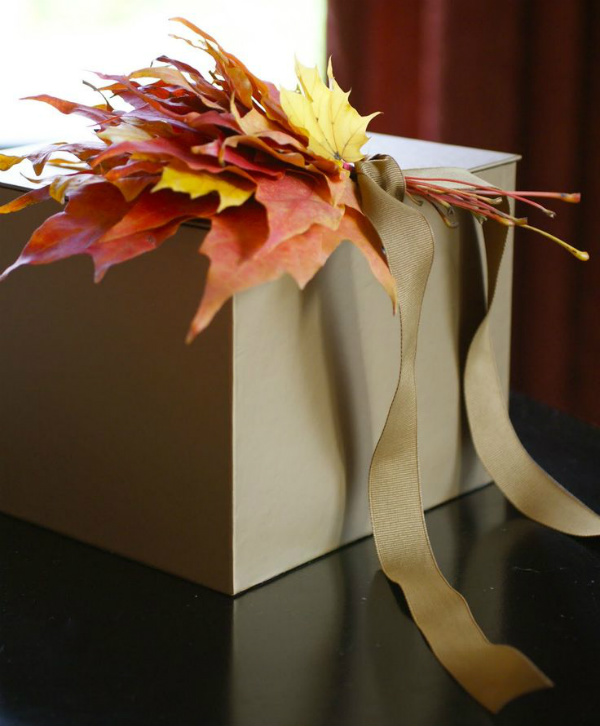 Gift box with autumn leaf bouquet