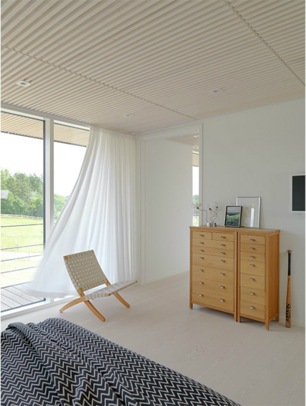 Scandinavian bedroom with floaty white curtains