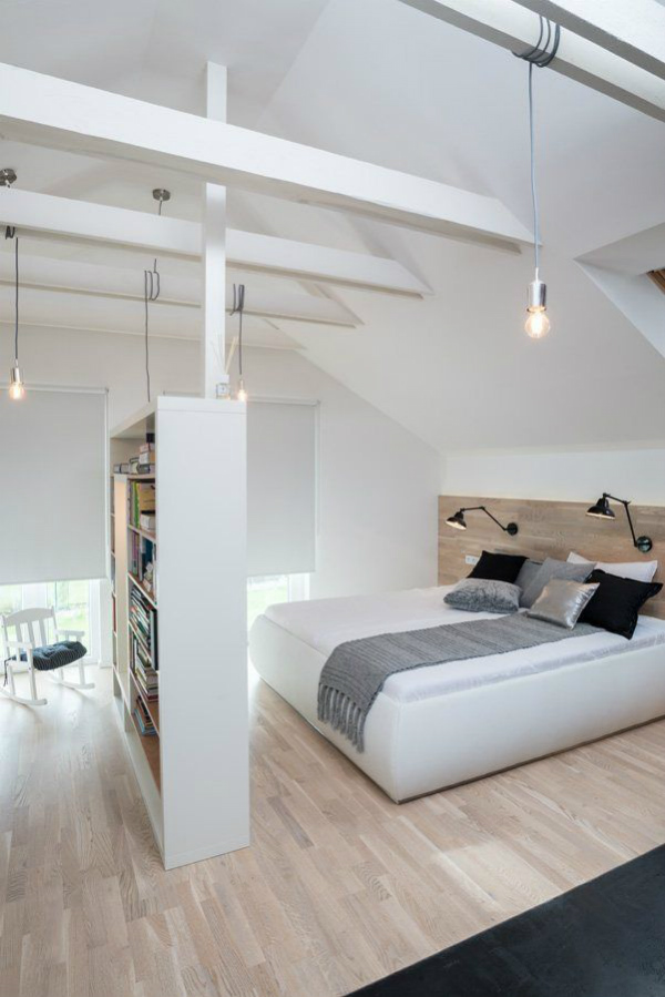 Bookcase used as a room divider to create bedroom in open plan space