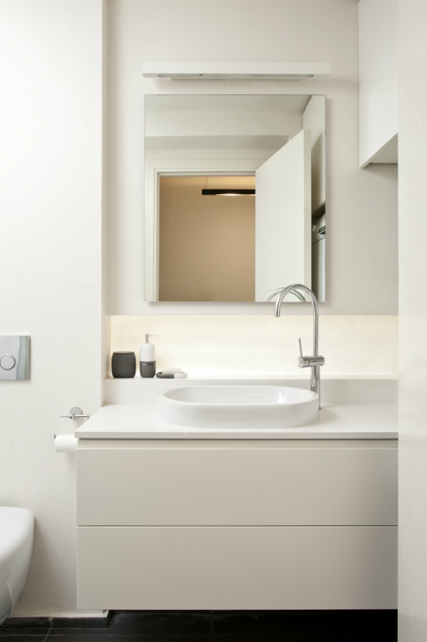 Bathroom in the box of an one bedroom apartment transformed from a studio