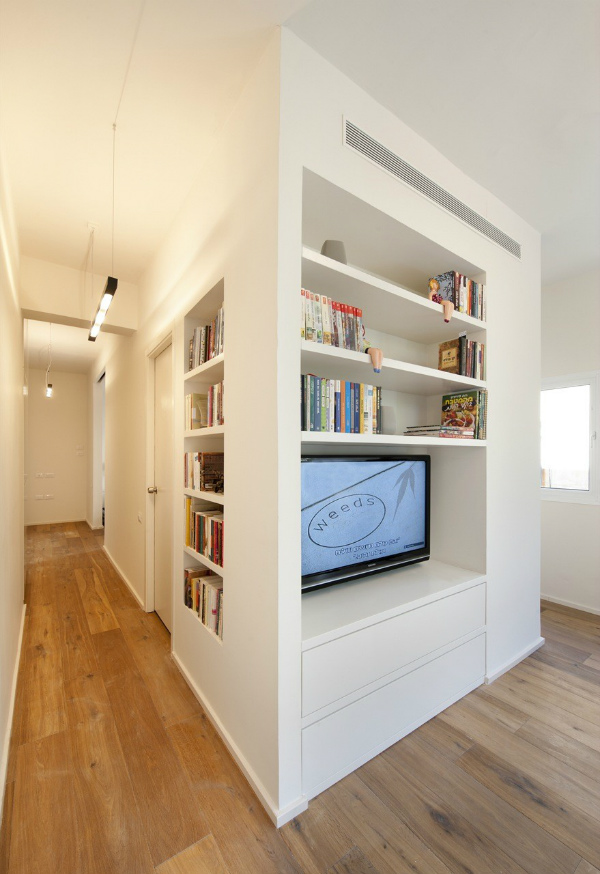 The living room and hallway of a studio apartment in Tel Aviv transformed into a spacious one bedroom flat | Read the full story on Mocha Casa blog