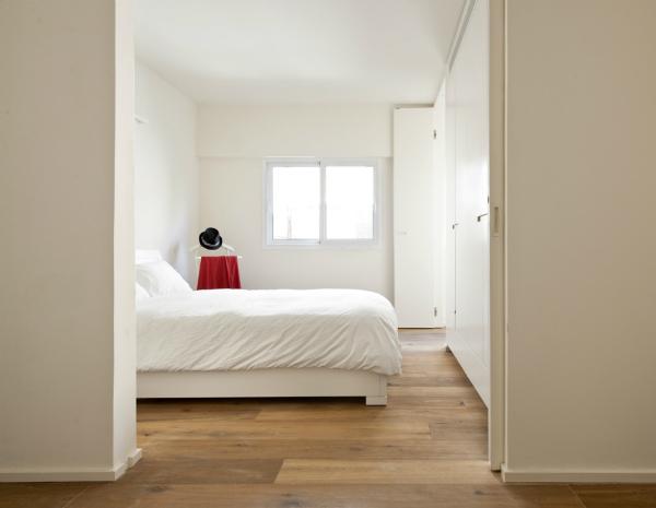 Minimalist white bedroom with a Scandinavian design feel