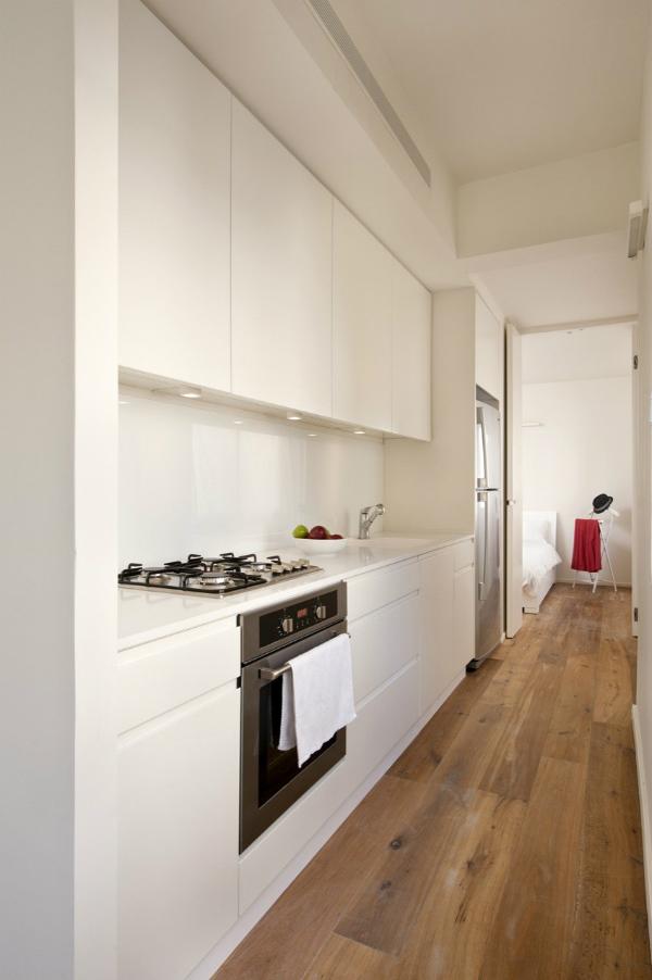 Minimalist white spacious kitchen in small apartment