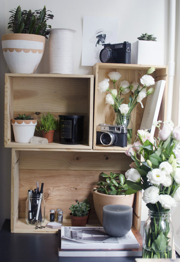 Desk shelves in a home office filled with plants and flowers