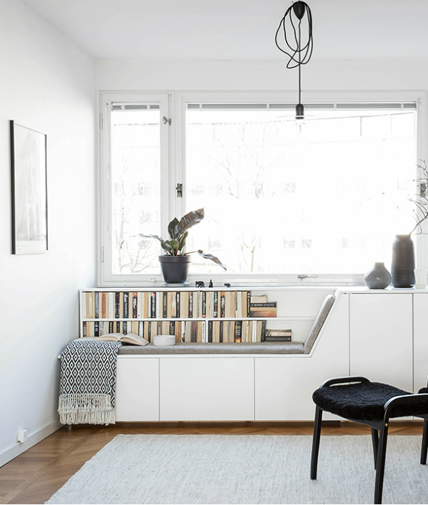Window seat with bookshelves and storage on mochacasa blog