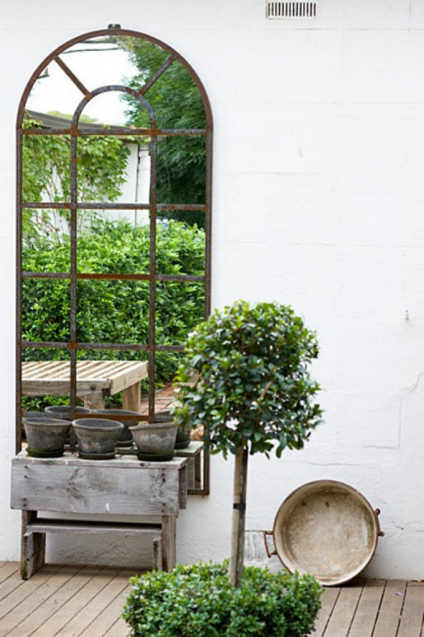Garden mirror to make an outside space look bigger