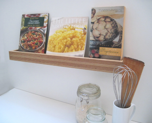 Picture ledge with display of cook books