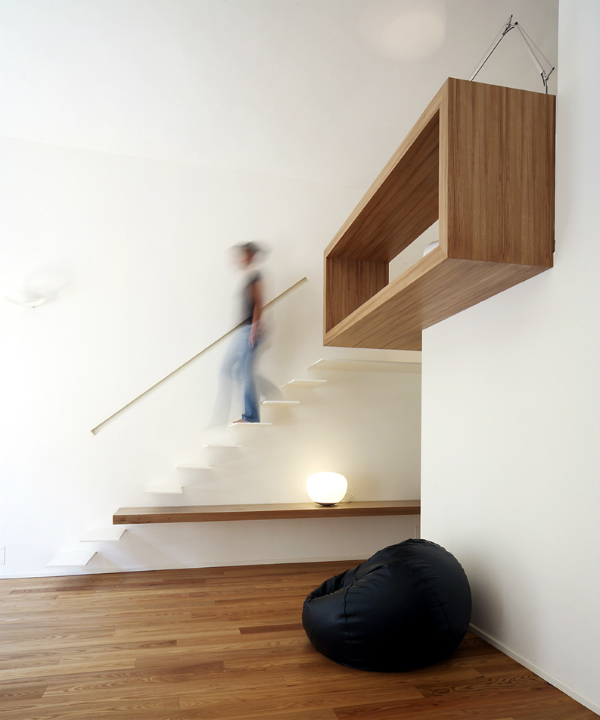 Cantilevered white minimalist staircase