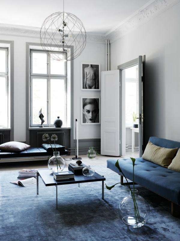 Sophisticated minimalist monochrome living room with serenity blue sofa