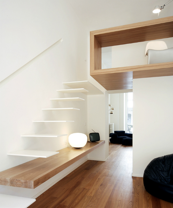 Minimalist cantilevered white staircase with loft home office