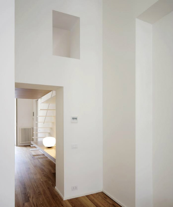 Minimalist apartment in white and wood
